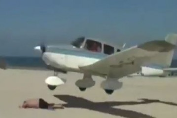 Plane almost lands on man sunbathing on a beach in Germany