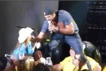 Luke Bryan Pulls young girl on stage to see her moves! Gonna be a big star one day!